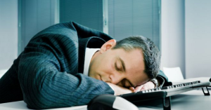 Businessman-sleeping-at-desk